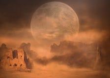 Полнолуние на горных пиках пустыни на пыльной буре Стоковые Фото