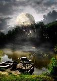 Полнолуние над рекой Стоковое Изображение