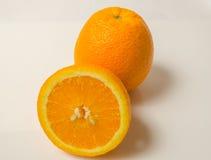 Полный & половинный апельсин Стоковая Фотография