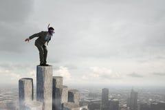 Подныривание бизнесмена от верхней части Мультимедиа Мультимедиа Стоковое фото RF