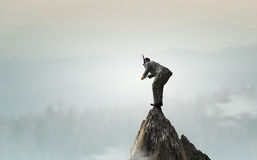 Подныривание бизнесмена от верхней части Мультимедиа стоковые изображения rf