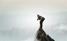 Подныривание бизнесмена от верхней части стоковое фото rf