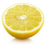 Половина желтых цитрусовых фруктов лимона изолированных на белизне Стоковое Фото