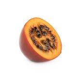 Половина зрелого изолированного плодоовощ tamarillo Стоковое фото RF