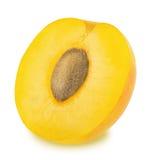 Половина зрелой желтой изолированной сливы Стоковая Фотография