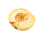 Половина изолированного плодоовощ персика Стоковые Изображения