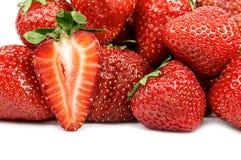 Половина клубник на предпосылке ягод Стоковая Фотография RF