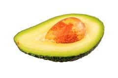 Половина отрезанного авокадоа на белой предпосылке Стоковые Изображения