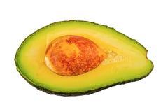 Половина отрезанного авокадоа на белой предпосылке Стоковое Изображение