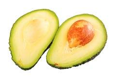 Половина 2 отрезанного авокадоа на белой предпосылке Стоковые Фото