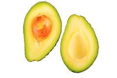 Половина 2 отрезанного авокадоа на белой предпосылке Стоковое Фото