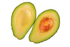 Половина 2 отрезанного авокадоа на белой предпосылке Стоковые Изображения