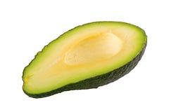 Половина отрезанного авокадоа на белой предпосылке Стоковые Фотографии RF