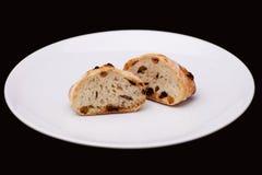 Половина 2 плюшки сандвича с изюминками Стоковые Фото