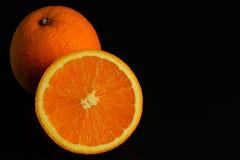 Половина разделенная апельсинами Стоковая Фотография RF