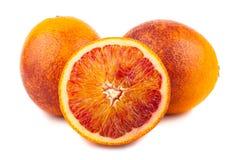 Половинные и польностью кровопролитные красные апельсины Стоковое Изображение
