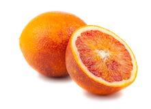 Половинные и польностью кровопролитные красные апельсины Стоковая Фотография