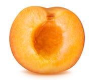 Половинный зрелый абрикос изолированный на белой предпосылке Стоковая Фотография