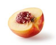 Половинный персик с камнем Стоковая Фотография RF