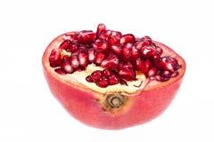 Половинный плодоовощ красного гранатового дерева изолированный на белой предпосылке Стоковые Фотографии RF