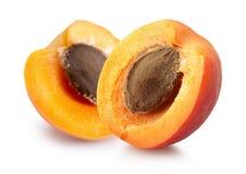 2 половины абрикоса изолированной на белой предпосылке Стоковая Фотография