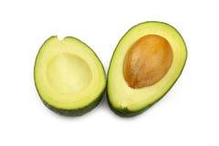 2 половины авокадоа изолированной на белизне Стоковые Изображения RF