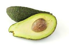 Половины авокадоа изолированные на белизне Стоковая Фотография