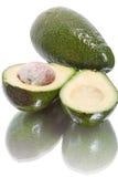 Половины авокадоа на белизне Стоковое Изображение