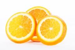 Половины апельсина на белой предпосылке Стоковые Фото