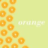 Половины апельсина на зеленой предпосылке в форме folny Стоковое Изображение
