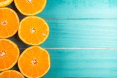 Половины апельсина на таблице Стоковое Изображение