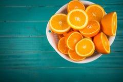 Половины апельсина на таблице Стоковые Фото