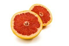 2 половины грейпфрута на белизне Стоковые Изображения RF