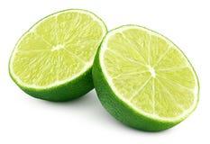 2 половины зеленых цитрусовых фруктов известки на белизне Стоковые Изображения RF