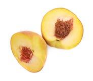 2 половины изолированного плодоовощ персика Стоковое Фото