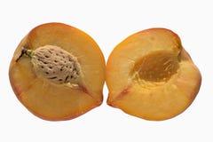 Половины персика с косточкой на белой предпосылке Стоковые Фото