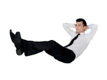 Положение бизнесмена расслабляющее Стоковое фото RF