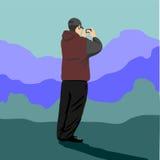 Положение человека и изображения гор Стоковая Фотография