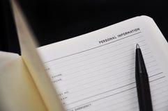 Положенная ручкой дальше персональная информация страницы стоковые фотографии rf