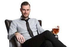 Положенный назад бизнесмен с пивом стоковое изображение rf