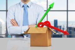 положите бизнесмена в коробку Стоковые Изображения RF