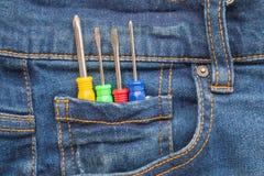 Положите инструменты в джинсы Стоковое Изображение