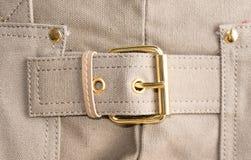 Положите текстуру в мешки ткани элемента грубую в бежевых цветах с золотым buc Стоковые Фотографии RF