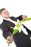 Положительный человек с цветком Стоковая Фотография RF