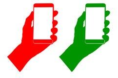 Подпишите зеленые и красные цвета показывая телефон в руке Стоковая Фотография