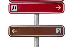 Подпишите при престарелое и дети указывая напротив путей изолированных на белизне Стоковые Изображения RF