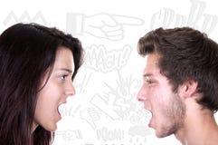 Подростки крича на одине другого стоковая фотография rf