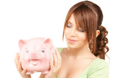 подростковое девушки банка симпатичное piggy Стоковая Фотография