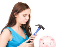 подростковое молотка девушки банка piggy Стоковые Изображения
