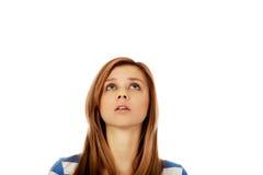 Подростковые глаза женщины смотря вверх Стоковая Фотография